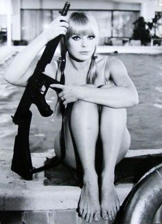 Elke Sommer. Because you never know when you might need a gun while swimming