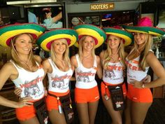 WOW 5 HOOTERS GIRLS, WEARING BRIGHTLY COLORED SOMBREROS!
