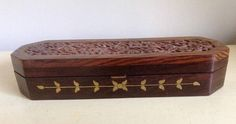 Unusually Long Vintage Box with Carved Floral Pattern Lid.