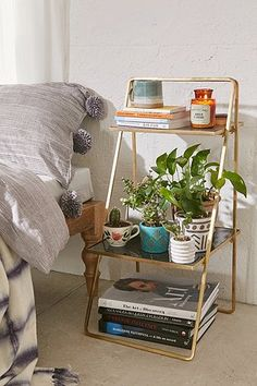 Zoe Plant Stand that works great as a bedside table. minimal gold plant stand.