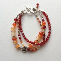 Carnelian and Hill Tribe Sterling Silver Triple Strand Bracelet. $75.00, via Etsy.