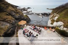 View of the Ceremony from Above, Love what the Groomsmen did on the beach in the morning :) - By Kensa Photography - www.kensaphotography.co.uk