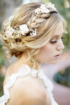 Bridal hair - love the babies breath and carnations in her braided updo