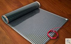 InfraFloor - Radiant Floor Heating Systems  THIS TYPE, FIRST I HAVE SEEN, DESIGNED SOLEY TO SAFELY INSTALL WITH LAMINATE/HARDWOOD FLOORS. CLICK ON PIC TO SEE HOW INSTALLED WHAT NEEDED AND PRICING. GOOD PLACE TO BEGIN EVALUATING PRODUCTS FOR CONSIDERATION