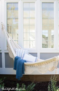 Gorgeous Hammock! One day I will have one. Plus it really dresses up a house/yard. Best hammock idea.