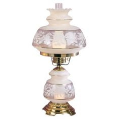 The base and top shades of this mouth blown table lamp give your space classic hurricane styling with rich gold accents. Mouth blown glass with flowers. French gold finish over metal. Style # 34453 at Lamps Plus. Hurricane Lamp Shade, Glass Hurricane Lamps, Lamp Sets, Lamp Shades, Frosted Glass, Milk Glass, Table Lamp, French, Lights