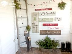 A Tree Farm Inspired Sign Wall in the mudroom at The Creek Line House.