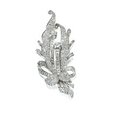 DIAMOND BROOCH, CHAUMET, 1950S. Designed as a stylised floral spray, set with circular-, single-, square-cut and baguette diamonds, signed Chaumet Paris.
