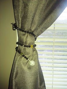My DIY beaded wire curtain tie-backs. Needed something that didn't stick out from the wall. :D