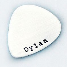 Thoughtful, unique and complete with a serious cool-factor, this personalized guitar pick is crafted from beautiful .925 sterling silver and features the name, date, or phrase of your choice. Whether you're a musician and want a sentimental reminder to keep playing, or you're giving this as personal gift, this special guitar pick will be cherished for years to come.