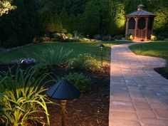 The Best Solar Path Lights for Your Lawn and Garden - Bob Vila Garden Path Lighting, Backyard Lighting, Landscape Lighting, Outdoor Lighting, Lighting Ideas, Lighting System, Outdoor Decor, Modern Landscape Design, Modern Landscaping