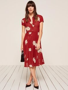 Like your dream vintage dress except better because it actually fits you. This is a collared, midi length dress with a button front bodice.
