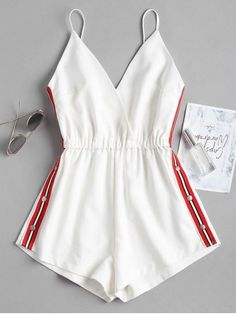 Snap Button Stripes Panel Romper. A classic, sporty cami romper is the perfect piece for a casual outing alike. The ribbons with a snap button closure and the stripes pattern that accent both sides polish the look of this romper. A surplice bodice that supported by the adjustable spaghetti straps finally finishes the look. Pair it with some simple sliders and you're good to go. #Zaful #Romper #Outfits