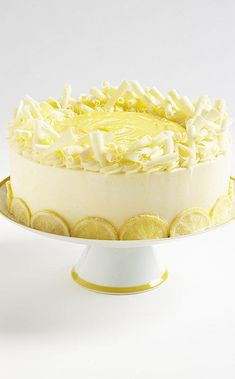 Lemon Lover's Cake: A lemon layer cake is an elegant way to greet spring. Like the season, lemon cake can resemble either a lion or a lamb. With potent citrus punches in the cake, frosting, lemon curd topping, and candied lemon garnish, our cake positively roars. Lemon Recipes, Cake Recipes, Dessert Recipes, Fancy Cakes, Cute Cakes, Just Desserts, Delicious Desserts, Lemon Pudding Cake, Lemon Layer Cakes