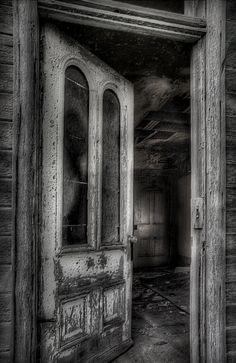 I Dare Ya... Another old abandoned house on a forgotten highway... Now this one, I must admit, was a little creapy...  later when i developed the picture further I noticed what looked like an old woman with a bun hairdo looking down on the inner window pane... really creapy...