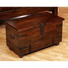 William Sheppee Thakat Small Blanket Box by William Sheppee USA. $314.67. Hand forged iron hardware. Hinged lid. Extra storage. Walnut stain. Made of shesham wood. This Thakat box makes a great coffee table, toy chest or use at the end of a bed. The hinged lid opens for extra storage. A great place to store throws, games or family treasures. Styled after old world tea trunks and made from shesham wood. Stained a rich walnut color and finished with black hand for...