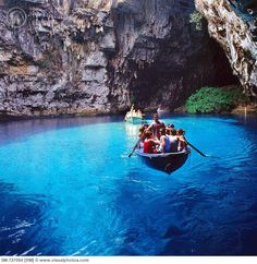 Ride a boat in such clear, blue water (Melissani, Kefalonia, Greece) Honeymoon Spots, Vacation Spots, Oh The Places You'll Go, Places To Travel, Europe, Beautiful Places To Visit, Greece Travel, Greek Islands, Dream Vacations