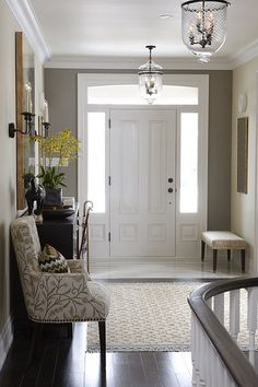 entry way. Door with 2 side windows and small tile section by the door, then wood floors.