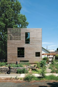 A basic box that's as tall as it is wide (28 feet) and 16 feet long, this Portland, Oregon house consists of rooms stacked vertically: an unfinished basement on the bottom, a kitchen-living area and a bathroom in the middle, and a bedroom on top, with the stairwell hinged onto the front of the home. The only interior doors are those to the bathroom, basement, and root cellar, leaving the rest of the space open and unfettered. At just 704 square feet, Katherine Bovee and Matt Kirkpatrick's…