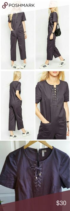 """ASOS Relaxed Lace Up Jumpsuit ASOS Relaxed Lace Up Jumpsuit  *Eggplant purple color *Size US 2 - Pit to pit : 17.5"""" flat / Inseam : 23""""  *Loose fit / Lace up front / two functional front pockets  *100% Cotton  *In excellent pre-loved condition with minimal signs of wear  *No trade ASOS Pants Jumpsuits & Rompers"""