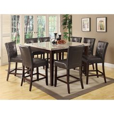The rectangular-shaped table features a beige marble top and carries a rich cappuccino finish. The matching side chair includes a dark brown leatherette upholstered seat and back with tufting as well as sophisticated stitching.