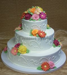 Flowers in vibrant colors made this wedding cake summery and beautiful! By Dessert Works Elegant Wedding Cakes, Beautiful Wedding Cakes, Buttercream Wedding Cake, Summer Cakes, Handmade Chocolates, Pretty Cakes, Cake Designs, Cupcake Cakes, Cupcakes