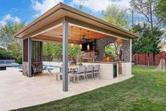 Have fun poolside with this gorgeous covered outdoor kitchen by Texas Custom Patios.