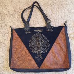 Beautiful shoulder bag with paisley print Suede and leather navy and brown shoulder bag. With beautiful printing. The inside is lined in red. Mitzi Baker Bags Shoulder Bags