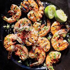Prawns al Mojo de Ajo - 1/2 cup olive oil 1/2 cup finely diced white onion 3/4 teaspoon kosher salt, divided 8 garlic cloves, minced 1/4 cup chopped fresh flat-leaf parsley 1/4 cup fresh lime juice 16 large shrimp, deveined and shells on Cooking spray 1/2 teaspoon freshly ground black pepper 1 serrano chile, thinly sliced