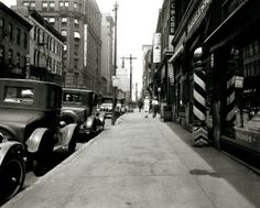 View looking up the sidewalk on Pine Street west of Broadway. Globe-Democrat Building at the southwest corner of Sixth and Pine. (1926 to 1931)