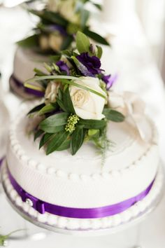 purple ribboned wedding cake...simplicity can be gorgeous...