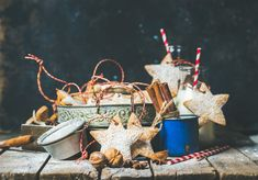 Christmas star shaped cookies, decoration rope, nuts, spices, milk bottles - Christmas festive star shaped gingerbread cookies or biscuits in vintage tray, decoration rope, nuts, spices, milk for Santa in bottles with straws, sugar powder. Selective focus, copy space