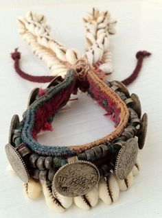 "India | Old ""Kandiya"" bracelet with old coins, beads, cowrie shells and thread work from the Banjara (Gypsy) people 