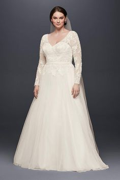 David's Bridal has beautiful plus size wedding dresses that come in a variety of sizes & full figured styles for an affordable price. Book an appointment today!