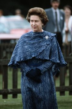 I really love this on the Queen! In a bit of a style departure for the Queen, attending the Royal Guards polo match, with this beautiful coat and matching shawl, pinned with a diamond brooch - very unusual and very smart actually ! God Save The Queen, Hm The Queen, Royal Queen, Her Majesty The Queen, Queen Mary, Princess Elizabeth, Princess Margaret, Queen Elizabeth Ii, Princess Mary