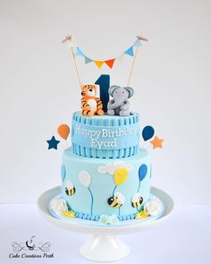 Cute 1st birthday cake for little Eyad. Underneath was a light a fluffy chocolate sponge cake with a vanilla buttercream filling. Based on a photo supplied by the client.