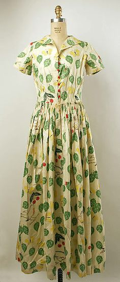 Day Dress, circa 1930s. This dress represents some of key design aspects that were popular after the stock market crash. The hemline dropped (knee to floor length) and the natural waist is emphasized once again. This particular dress is printed and made of cotton.