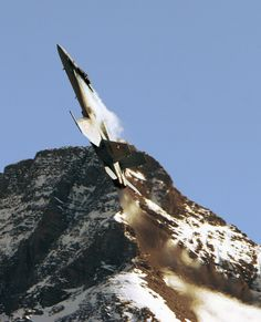 youlikeairplanestoo:  A Swiss Air Force F-18 archs skyward after a strafing run at Axalp 2005. Photo by Fadrillo. Full version here.