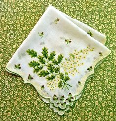 Vintage handkerchief. My Grandmother, Mother and even myself used cloth handkerchiefs.  My Dad and Granddad carried plain white handkerchiefs in their pockets. We did not buy Kleenex...not even sure if Kleenex was even around back then.