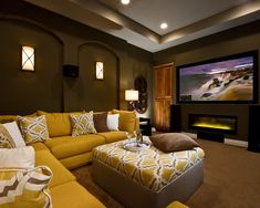 Comfy casual Simple Media room, love the yellow sofa and ottoman essential :-)