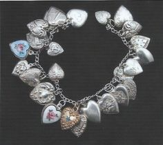 Vintage Sterling Silver Charm Bracelet w/ 25 Sterling Silver Puffy Heart Charms