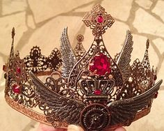 Custom steampunk crown by Karen Troeh. Antique copper filigree, red and black glass stones, wings and gears. This one is sold, but visit my Etsy shop for other items or to request your own custom design.