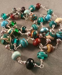 Teal and Autumn Murano glass lamp work bead necklace wired together rosary style with sterling silver wire by DestinyPier on Etsy