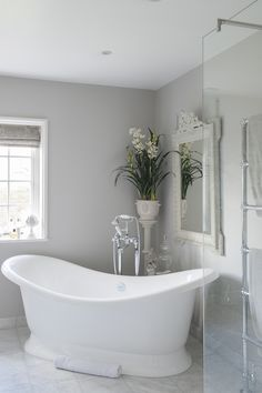 The volcanic limestone double-ended bath is large enough to accommodate Victoria and both children. The volcanic limestone double-ended bath is large enough to accommodate Victoria and both children. Gray Bathroom Walls, Light Grey Bathrooms, Beautiful Bathrooms, Bathroom Interior, Bathroom Bench, Bathroom Colours, Grey Kitchen Walls, Rental Bathroom, Ikea Bathroom