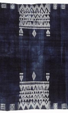 Africa | Detail from a shawl, Bakhnuq, from Tunisia | Wool & cotton; the indigo field with two central rectangular panels of white zig-zag and pendant motifs, with geometric borders, tassel fringes to either end