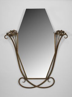 Art Deco Wall Mirror manner of edgar wood art deco wall mirror, circa 1930, of