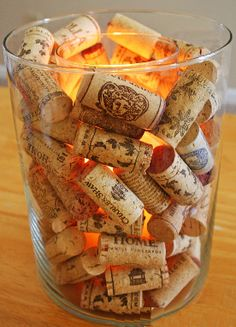 #wine corks #wedding decorations #placecard holder  Use wine corks to fill vases or as place card holders. http://www.bliss-bridal-weddings.com/#!product/prd3/3408808855/90-new-wine-corks
