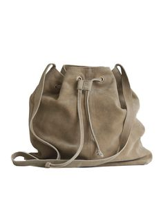 Tell Me More Boho Bag: Suede bag with details in metal and a cotton lining. Long strap which make the bag nice cross body as well as on just one shoulder.