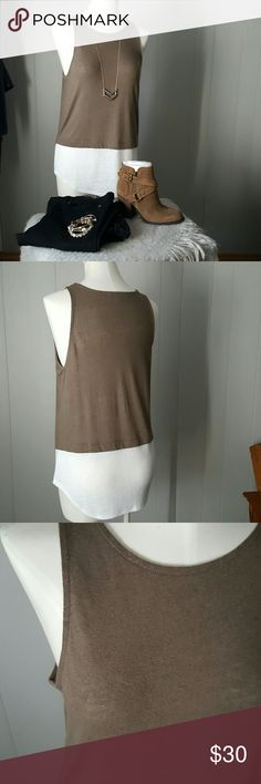 "Linen Blend Tank | Brand New! Create the layered look without the bulk! Top tank has a finished hem before the white begins at bottom.  Tank can be edgy- add a cropped  leather jacket, heels,  and black skinny pants,  or casual by adding a long necklace and some booties. Longer length,  roomy fit. Fabric is a linen blend which gives it a textured look- see 3rd photo.  * Color:  Olive Green * Bust: 18"" (at bottom of arm holes)  *Arm opening:  9.5"" * Length:  27"" (top to bottom)     20"" (green…"
