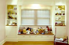 built-ins with cabinets and deeper window seat